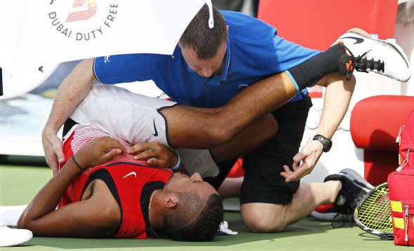 epa05180036 Nick Kyrgios of Australia receives treatment during his quarter final match against Tomas Berdych of the Czech Republic at the Dubai Duty Free Tennis ATP Championships in Dubai, United Arab Emirates, 25 February 2016. EPA/ALI HAIDER
