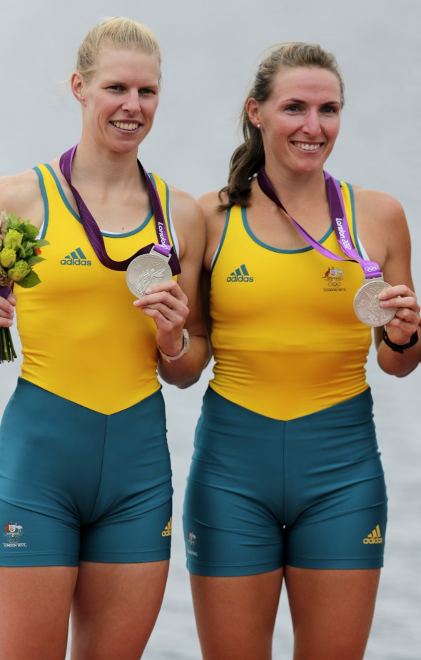 epa03331972 Australia's Kate Hornsey (R) and Sarah Tait celebrate their silver medals after the Women's Pair during the London 2012 Olympic Games Rowing competition at the Eton Dorney rowing centre near the village of Dorney, west of London, Britain, 01 August 2012. EPA/JIM HOLLANDER